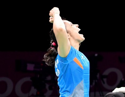 Lee, Nehwal Triumphant – Finals: XXI Commonwealth Games